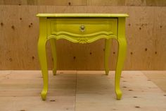 Queen Anne Style vintage Yellow side table with one small drawer for storage.