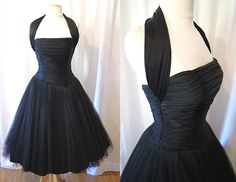 On Hold Lovely 1950's black silk jersey and tulle halter new look party dress bombshell vlv pin up girl chic - size XS to Small. $298.00, via Etsy.
