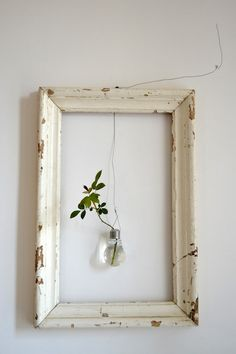 - empty frame with suspended lightbulbvase plus leaves - Orietta Marcon of Vicenze-based design studio Civico Quattro in a loft in italy. inspired living room A Rustic Loft in Italy, from a Rising Design Star - Remodelista Cuadros Diy, Empty Frames, Empty Wall, Empty Picture Frames, Old Frames, Wall Decor, Room Decor, Frames Decor, Frames Ideas