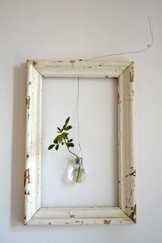 old frame, lightbulb vase