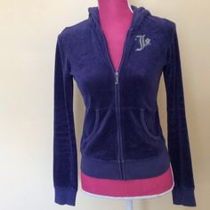 Juicy Couture dark purple velour zip up Juicy's cutest!  Dark purple velour JC zip up hoodie. Two rounded front pockets. Signature Rhinestone J with rhinestone flower on front. Rhinestone J with rhinestone crown and detailing in back. Juicy Couture Jackets & Coats