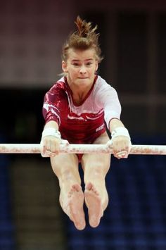 Anastasia Grishina, 16, of Russia practises on the Asymetric Bars during training sessions for artistic gymnastics ahead of the 2012 London Olympic Games.  (Christian Petersen / Getty Images) / SF
