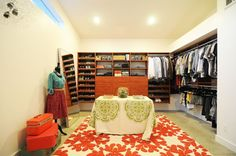 Reachel had a blank slate of a walk-in closet to work with. Her empty room was transformed into a master closet straight out of a fashionista's dreams!