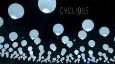 CYCLIQUE was an aerial light and sound installation created by audiovisual artist Nohista and Collectif Coin for Nuit Blanche 2013. The array of 256 large white balloons was embedded with LEDs that blinked in sequence with various audio tracks and was further enhanced by the impact of wind which altered the layout and motion of the piece.