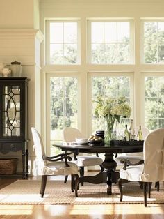 This wall of windows is absolutely stunning! Love the deep dark wood tones against alllthat creamy white!