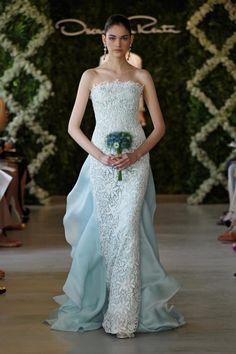 Oscar de la Renta, 44E01 in Ice Blue, found on http://citygirllovesweddings.com/2013/07/20/designer-friday-oscar-de-la-renta/