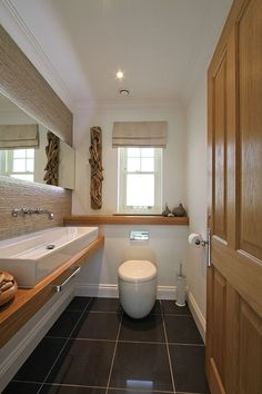 This cloakroom uses wooden elements to beautiful effect.