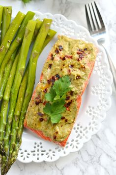 Steamed in foil packs, this low carb recipe is made with a nut free pesto. A quick and easy Paleo and gluten free salmon meal! Healthy Salmon Recipes, Seafood Recipes, Dinner Recipes, Cooking Recipes, Dinner Ideas, Fish Recipes, Meat Recipes, Meal Ideas, Ketchup