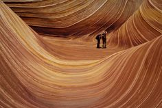 The Wave, Arizona. Located in Paria Canyon-Vermilion Cliffs Wilderness near the Arizona-Utah border lies The Wave, a sandstone rock formation that looks look a painting. The sight is known for its vibrant colors and the trackless hike to reach it.