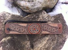 Heartagran hand carved leather bracelet  tooled by DIONESAMBROZIUS