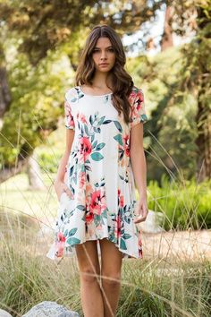 Great casual jersey dress in off-white featuring an allover floral print. A-line swing fit with two side pockets. Pullover style. 95% Rayon 5% Spandex. If in-between sizes, we recommend ordering the s