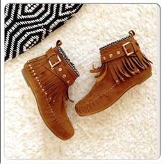 LISTING! NIB Studded Fringe Moccasin Booties Tan NIB Studded Moccasin Booties. The best moccasins for any boho look! Draped fringe with woven ankle detailing. Gold studded adjustable ankle straps. Inner ankle zippers for easy on and off wear. Rounded toe, textured sole, man made materials. FITS TRUE TO SIZE. Available in sizes 5, 5.5, 6, 7 No Trades and No PaypalWill not be restocked! Sold out of 6.5, 7.5, 8, 8.5, 9, 10. Shoes Moccasins