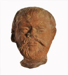 Egyptian terracotta figure of a bearded man.  Naukratis 3rdC BC-2ndC BC  Registration number: 1886,0401.1416
