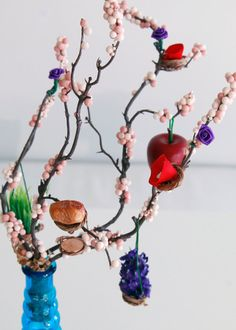 Nowruz: First day of Spring means New Day in Persian language and marks a traditional holiday festival celebrated in Iran and many other countries as it signifies the start of the new year.  This decorative Persian New Year display is called Haft Seen and contains 7 symbolic Ss placed on an artificial tree branch in a beautiful red glass vase. This artwork is a compact small size long lasting Nowruz decor most suitable to display in small living spaces, formal offices and homes of busy…