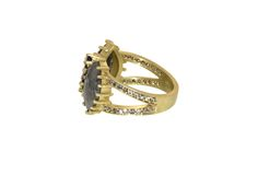 Another look at our 18K Gold Sapphire and Diamond Slice Ring with a Pavé Band