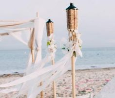 Tiki torches lining the aisle of your beach wedding.
