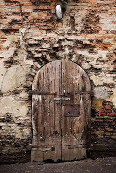 .weathered door in a crumbling wall... beautiful