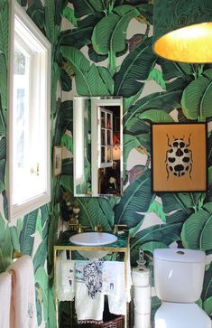 I want this powder room!  The leaf paper and the green marble pedestal!  To die... @Life of Style
