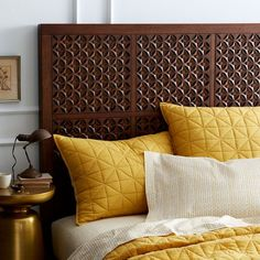Beautiful hand-carved wooden headboard.