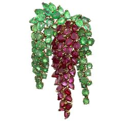 Marshak Mid-20th Century Ruby, Emerald and Gold Brooch | From a unique collection of vintage brooches at https://www.1stdibs.com/jewelry/brooches/brooches/
