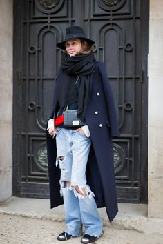 Denim in street style. Ripped, frayed boyfriend jeans at London Fashion Week Spring 2015. #rippeddenim #lfw