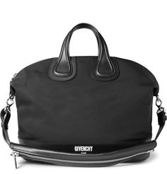Expertly crafted in Italy from durable canvas, <a href='http://www.mrporter.com/mens/Designers/Givenchy'>Givenchy</a>'s generously proportioned holdall is trimmed with sleek leather and silver hardware. The white designer stamp on the structured base marks it out as a distinguished piece by the esteemed Gallic label. Its fully lined interior is spacious enough to store everything you need for a weekend away and features zipped and slip pockets to keep smaller items in check.