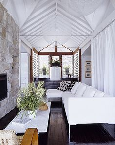 P&B home w/ tone-on-tone stonework and draped room dividers - love!