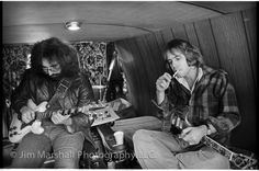 "Jerry Garcia and Bob Weir tune up in a Dodge van ""backstage"" at the Free Concert in Golden Gate Park with the Jefferson Starship on Sunday, Sept. 28, 1975 -- photo by Jim Marshall"