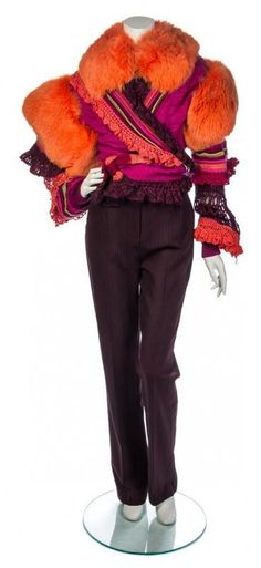 Bid 6/10 for Christian Lacroix Multicolor Knit Pant Ensemble, comprised of a wrap sweater with orange #fur cuffs, a brown striped #wool pant and an #orange fur #scarf, together with a set of matching knit sleeves and a pair of mismatched knit sleeves. Labeled: Christian Lacroix.  Pants size 40.  Estimate $100-200  |  #ChristianLacroix #Lacroix #fashion #couture @les  Fuschia, maroon, orange, pink and green wrap sweater. Scarf has hook and eye closure.