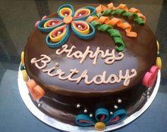 Torta buon compleanno - Torta buon compleanno con glassa lucida al cioccolato.