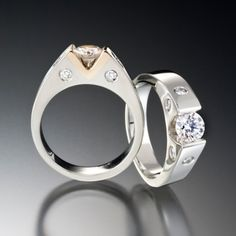 Setting price starts at $2980. Omni ring is sleek and refined. A stylish token of love. This unique ring is available in several gorgeous variations. The picture shows a .50 carat round center diamond and .25 carats total weight of flush set accent diamonds in a 14kt white gold setting.  Call (949) 715-0953 to purchase or click below for more information.