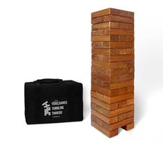 """Get your favorite GIANT stacking game with a beautiful stain and finish for perfect game play. This Giant Tumbling Timbers set includes 56 - 1.5"""" x 2.5"""" x 7.5"""" pieces and 19 rows of tumbling timbers fun! This timber game, also known as giant jenga, stands 2.5 feet tall, and depending on your level of experience, can reach a height of 6 feet! This game is great to take outdoors. Perfect for group events, parties, camping and more. Tumbling Timbers can be played by 2 or more players. First, build Solid Pine, Solid Wood, Outdoor Jenga, Outdoor Games, Giant Beer Pong, Tower Games, Giant Jenga, Giant Games, Wood Games"""