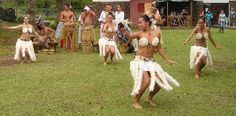 Polynesian dancing with feather costumes is on the tourist itinerary.