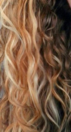 Blonde with strawberry blonde lowlights & platinum highlights