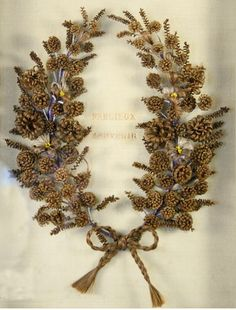 3foldlaw:    Victorian mourning wreaths made out of the hair of the deceased ~ shivers    what a lovely artifact!