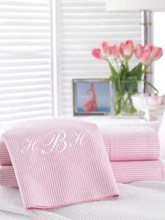 Monogrammed pink oxford sheet for Chloe's bed.