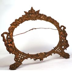 Antique-Rococo-style-oval-brass-picture-frame-with-Cherubs-other-decorations