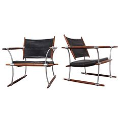 Pair of Rosewood Lounge Chairs by Jens Quistgaard | See more antique and modern Lounge Chairs at http://www.1stdibs.com/furniture/seating/lounge-chairs