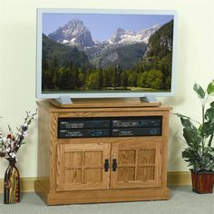 Amish Mount Hope Mission TV Stand Amish Mount Hope Mission TV Stand. Comes in two sizes and nine different wood types. Choice of wood or glass doors. Amish made in Ohio. #DutchCrafters