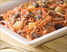 Sensational Sides – Carrot and Raisin Slaw with Pineapple and Pecans: This sweet carrot and raisin slaw with its gorgeous colors, is studded with plump raisins and juicy tidbits of pineapple, bathed in a honey-lime dressing.