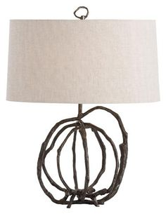 Arteriors In the Patrice lamp, hand-forged iron rods that resemble thin tree branches are wrapped into a spherical shape and topped with a natural linen shade, held in place with an equally unique finial. IHFC H320. www.arteriorshome.com