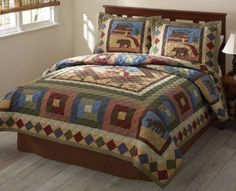 Hunting Cabin Bear and Moose Bedding by Timber Trails is perfect for the cabin retreat for those who enjoy deep colors and lodge style designs of moose, bear, and cabin patterns. This rustic cabin bedding starts with a quilt on a diamond framed pattern with accenting moose, bear, and cabin patterns inside a diamond pattern frame.