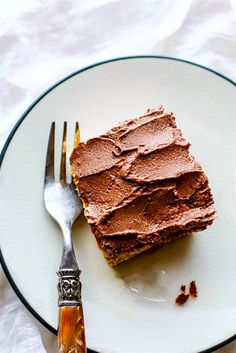 Easy Vegan White Cake with Chocolate Coconut Frosting. A gluten free, paleo friendly vegan dessert cake that tastes just like classic white cake! Super simple to make with natural ingredients and a total crowd pleaser. Great for celebrations or anytime of year!