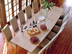 How to dress your dining table for Christmas dinner.  Table shown our Vision dining table in solid oak. https://www.berrydesign.co.uk/blog/dress-your-table-for-dinner/