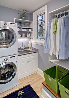 contemporary laundry room by Crystal Kitchen Center  stackable w/d cupboard shelf over sink hanging space