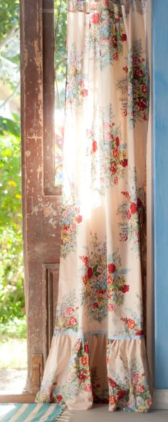I'm not typically a curtain person, but I love these as a way to soften a leather and wood filled western room.