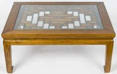"""CN1080Y-Chinese Coffee Table, Contemporary, Beijing China, Elm (Yumu), Asian Furniture: Coffee Table by Silk Road Collection. $925.00. Beijing, China. Wood. 44.75"""" wide x 32.5"""" deep x 20"""" high. Contemporary. A vintage Chinese screen is the center and feature of this newly crafted coffee table. The screen is designed in geometric patterns. The body of the coffee table is minimal to focus attention on the carved screen. The legs end in the traditional Chinese horse hoof design. Tab..."""
