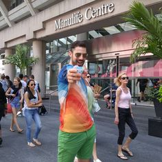 Shot by @stephenthomasm on Instagram --> heers to PRIDE! 😃😃😃 Hope everyone is having a fab night and remember to always be proud of who are! I stopped by @ManulifeCentre for some snow cones earlier today during the parade which was packed as always. @PrideToronto #BloorAndBetter #PrideTO.. #NuvangoStyle