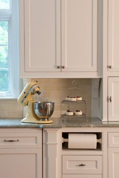 Window height, backsplash, paper towel niche, simple cabinets, appliance garage - Vintage KitchenAid mixer - Dessert stand - Transformation of a New England Style Home with 21st Century Embellishments - traditional - kitchen - bridgeport - Titus Built, LLC