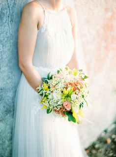 Love this gown + bouquet | Destination Portugal wedding | Photo by Andre Teixeira of Brancoprata